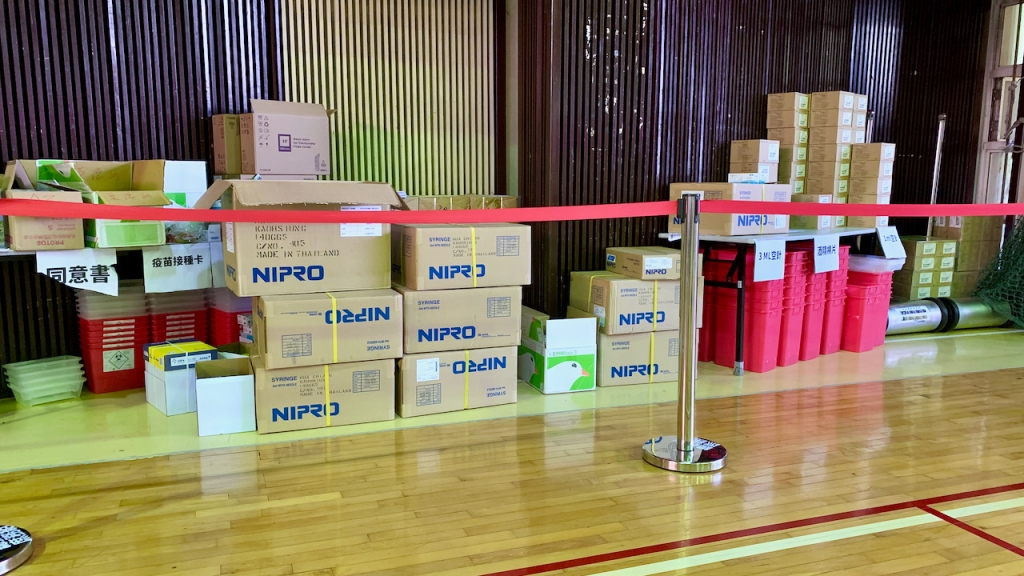 Boxes of supplies at the side of the room.